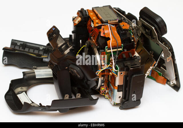 DSLR camera, broken into pieces. - Stock Image