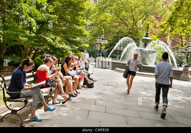 City Hall Park and fountain at lunchtime, summer, New York City - Stock Image