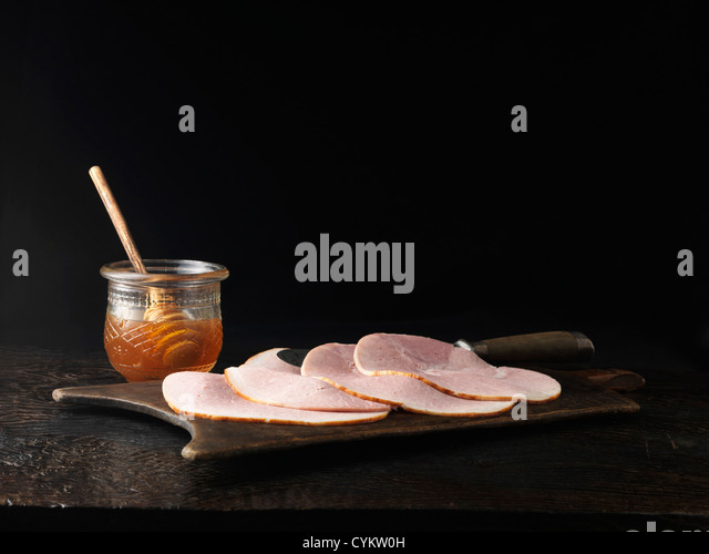 Jar of honey with plate of ham - Stock Image