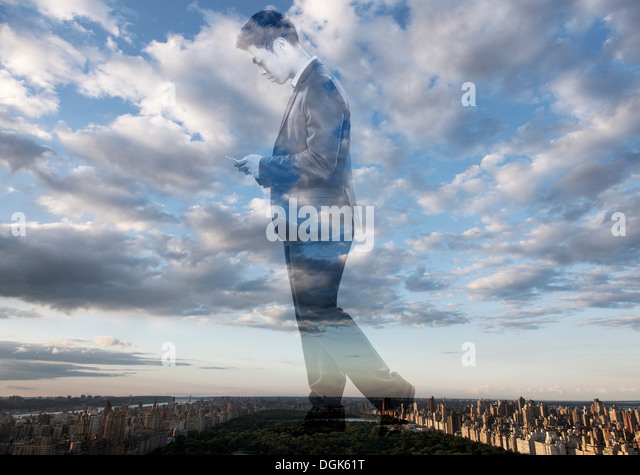 Double exposure of businessman against cityscape - Stock Image