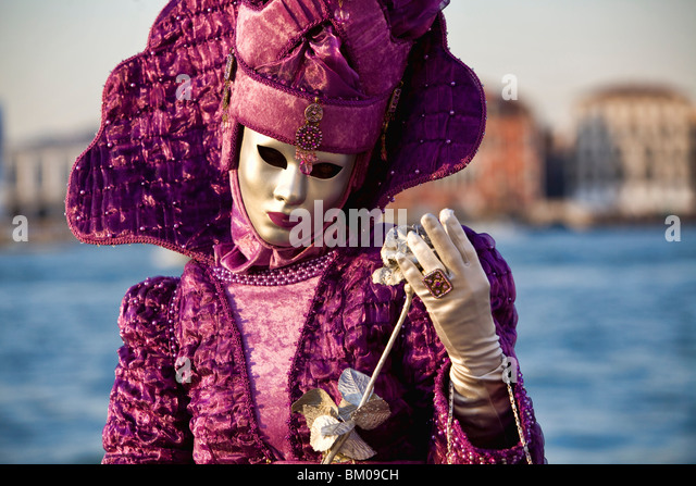 Woman wearing a costume in Carnival in Venice - Stock Image
