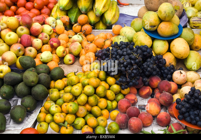 Assorted fruit in market stall - Stock Image