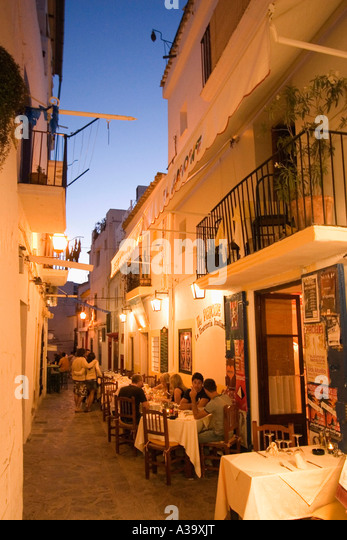 Spain Baleares island Ibiza town Dalt vila Restaurant outdoor in the evening - Stock Image
