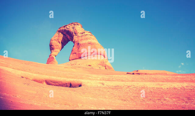 Vintage toned Delicate Arch at sunset, Utah, USA. - Stock Image