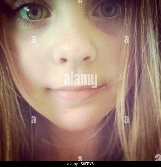 Girl with big eyes looking into camera. - Stock Image