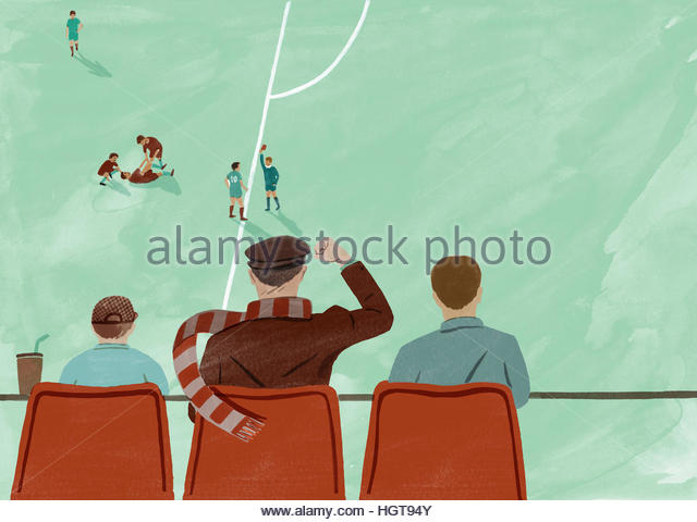 Father watching football match with sons celebrating footballer being sent off - Stock-Bilder