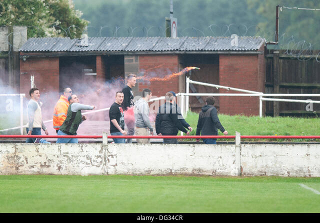 Atherstone, Warwickshire, UK. 12th October, 2013. A group of fans from the home end of the Sheepy Road ground walk - Stock Image