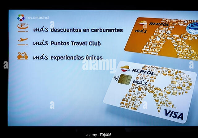 Madrid Spain Europe Spanish television TV screen media ad advertisement commercial Visa credit card Repsol Telemadrid - Stock Image