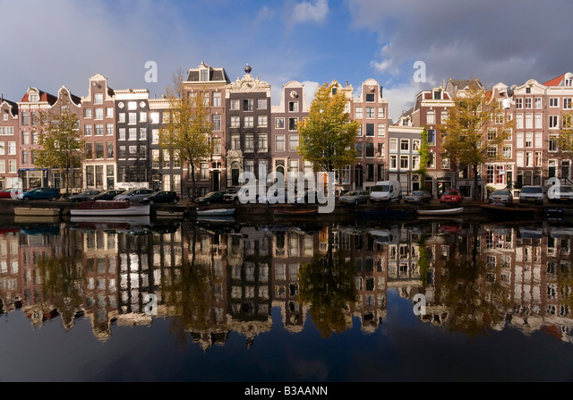 Holland, Amsterdam, traditional Gabled houses and reflections in canal - Stock Image