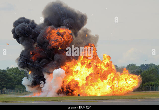 A pyrotechnic explosion on an airfield designed to illustrate a bomb attack - Stock Image