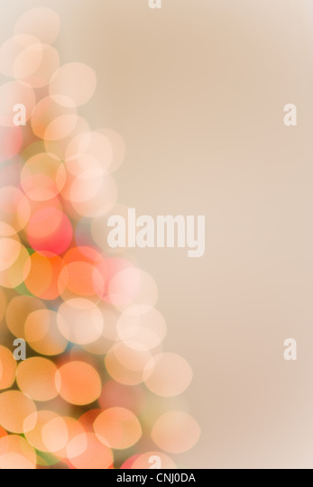 Christmas lights on tree, out of focus - Stock Image