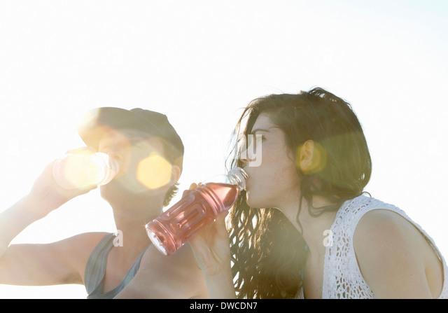 Young couple drinking soft drinks - Stock Image