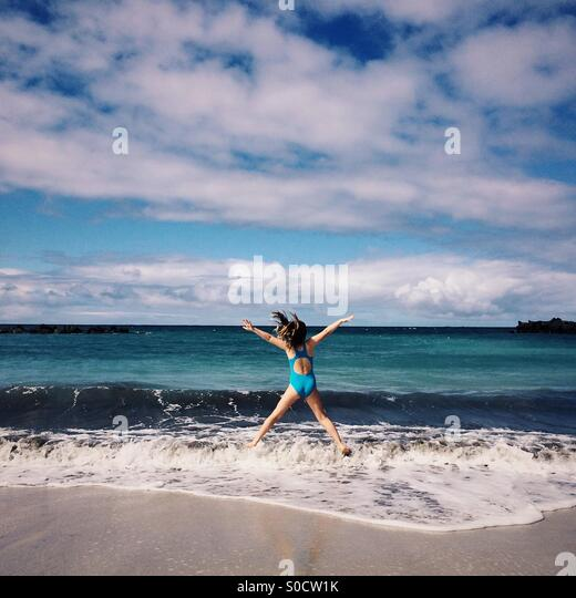 Girl playing on the beach, Costa Adeje, Tenerife, Canary Islands, Spain - Stock Image