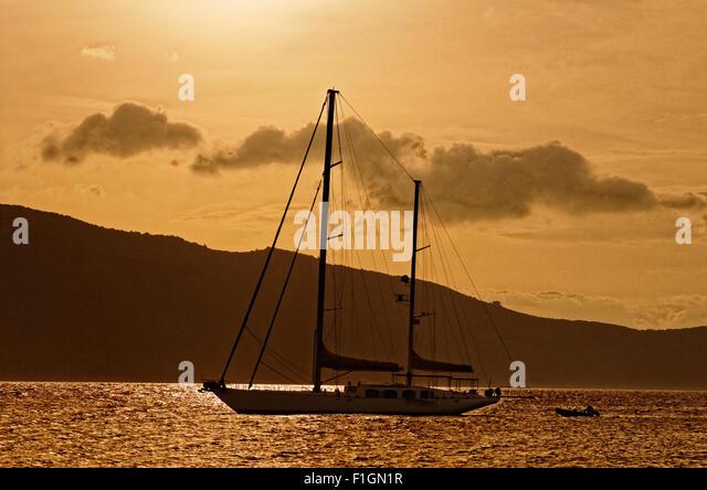Large sailing yacht at anchor. - Stock Image