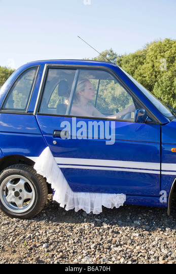 Young woman at wheel of electric car - Stock-Bilder