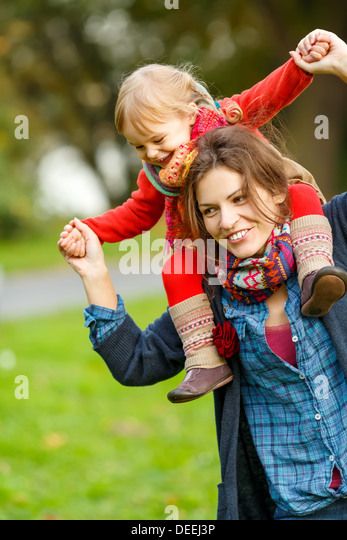 Mother and daughter playing in the park - Stock Image