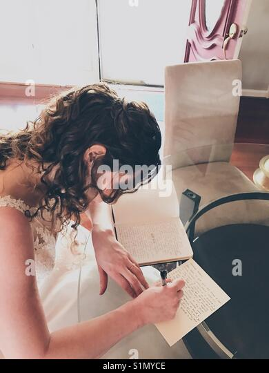 Just a girl on her wedding day. - Stock Image