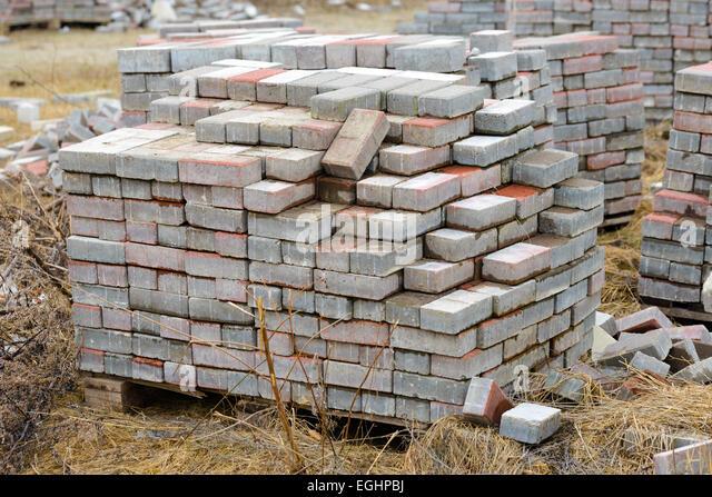 Calcium Silicate Brick : Stacked bricks on construction site stock photos