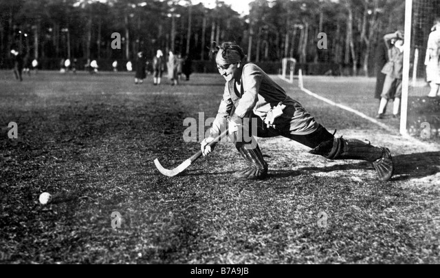 Historic photo, woman playing hockey, ca. 1925 - Stock Image