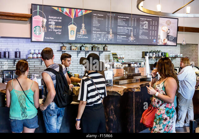 Madrid Spain Europe Spanish Centro Paseo del Prado Plaza Canovas del Castillo Starbucks Coffee cafe business brand - Stock Image