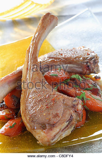 Lamb chops with five spices,carrots caramelized with honey and spices - Stock Image