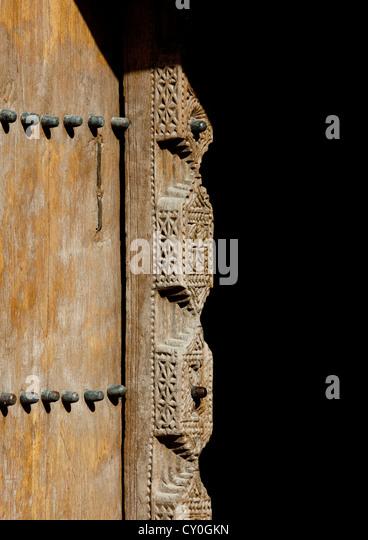 Old Wooden Carved Door In Nizwa Fort, Oman - Stock Image