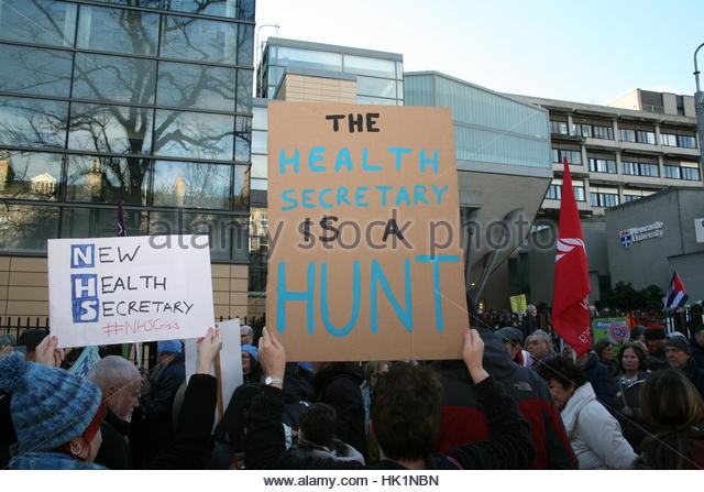 Newcastle, UK. 4th Feb, 2017. Protesters hold signs during a demonstration to to defend National Health Service - Stock Image