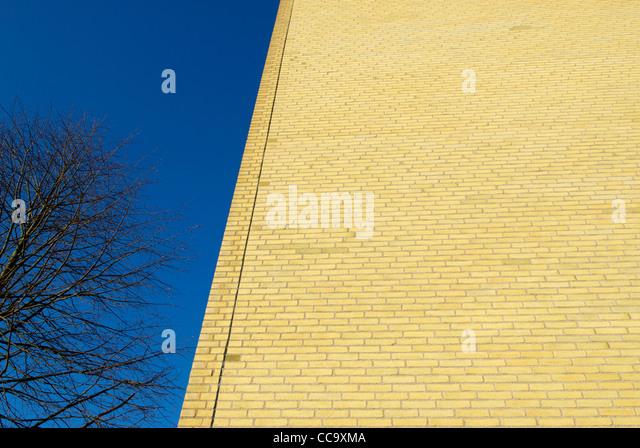 YELLOW BRICK WALL - Stock Image