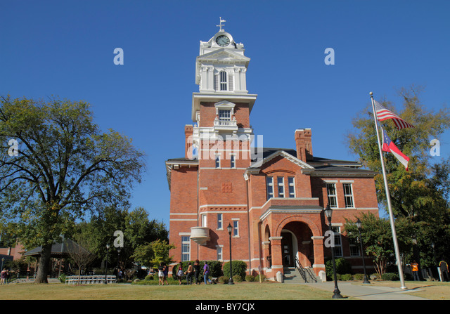Georgia Lawrenceville Gwinnett County Courthouse historic government building 1885 clock tower Romanesque architecture - Stock Image