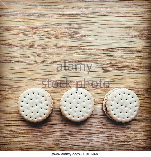 Close-Up Of Cookies On Wooden Table - Stock-Bilder