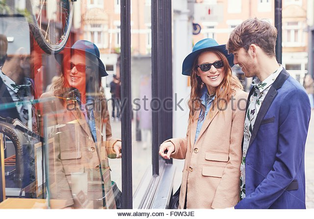 Stylish couple looking at shop window, London, UK - Stock Image