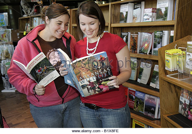 Arkansas Ozark Mountains Blanchard Springs Caverns book store gift shop girls teens two shelves bookstore travel - Stock Image