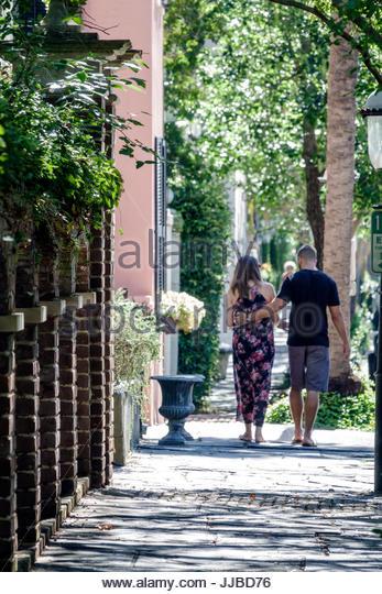 South Carolina Charleston SC Historic Downtown man woman couple strolling - Stock Image