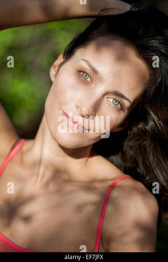 Portrait of a beautiful woman day dreaming - Stock Image