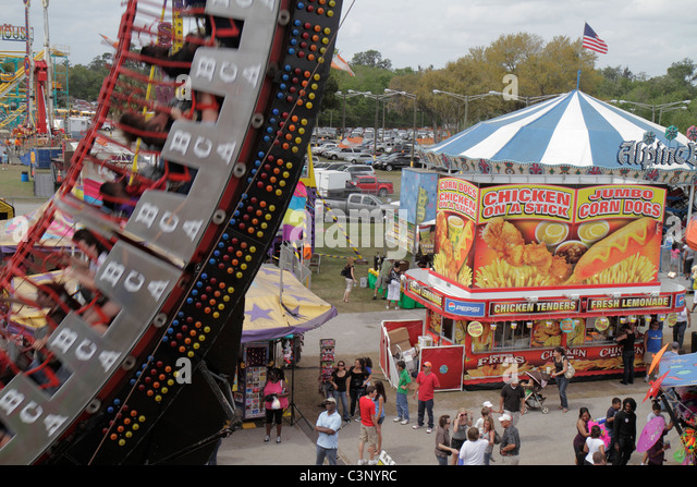 Florida Plant City Florida Strawberry Festival annual event carnival midway thrill ride food - Stock Image