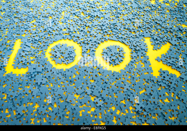 The word Look spelled out between jigsaw pieces - Stock Image