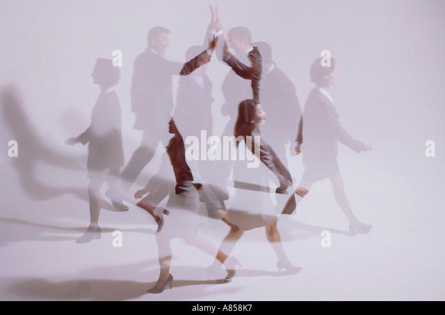 Double image impression of people walking. - Stock Image