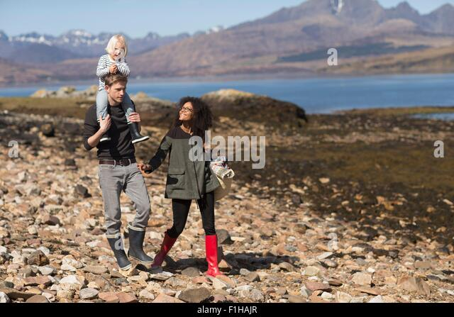 Family on walk, man carrying son on shoulders, Loch Eishort, Isle of Skye, Hebrides, Scotland - Stock Image
