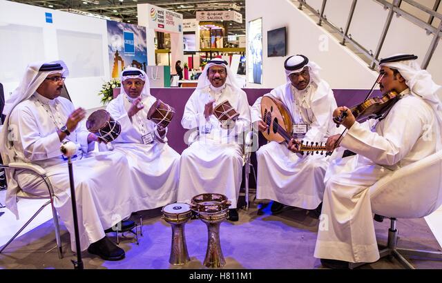 Qatar Arabs Playing Music at The World Travel Market London UK - Stock-Bilder