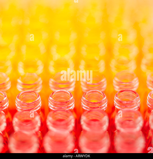 Vials filled with coloured liquid - Stock Image