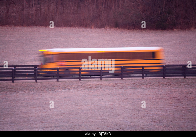 School bus in the early morning making a stop to pick up students, Franklin, Tennessee - Stock Image
