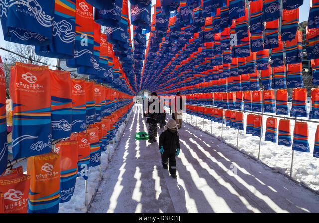 Ottawa, Canada, February 18, 2013.  Visitors of Ottawa Winterlude walk through the Tunnel of Lanterns at Confederation - Stock Image