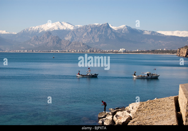 View of Taurus Mountains from the harbour of Old Antalya, Turkey - Stock Image