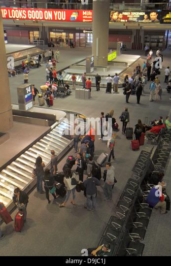 Nevada Las Vegas McCarran International Airport LAS terminal overhead baggage claim area luggage conveyor belt arriving - Stock Image