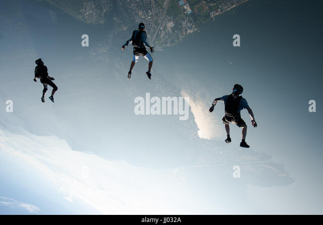Skydivers tracking towards Lago Maggiore, Switzerland - Stock Image