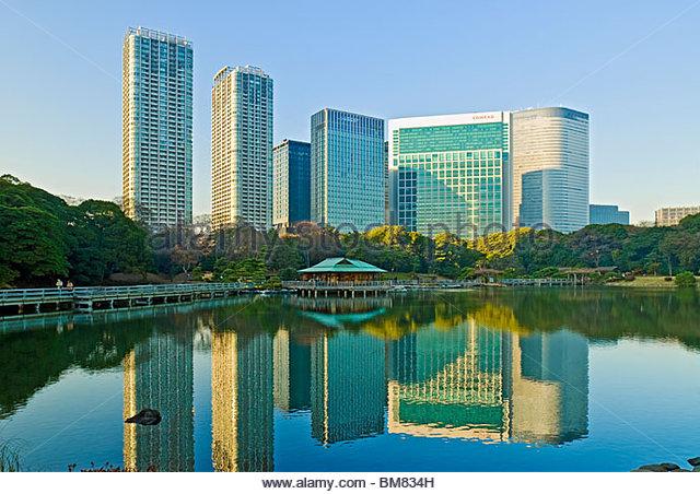 Hama Rikyu Gardens and Tokyo Skyline of Shiodome District, Japan. - Stock Image