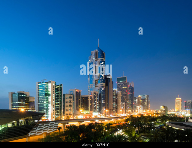 Dusk view of skyline of skyscrapers along Sheikh Zayed Road in Dubai United Arab Emirates - Stock Image