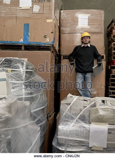 Man in recycling warehouse - Stock Image