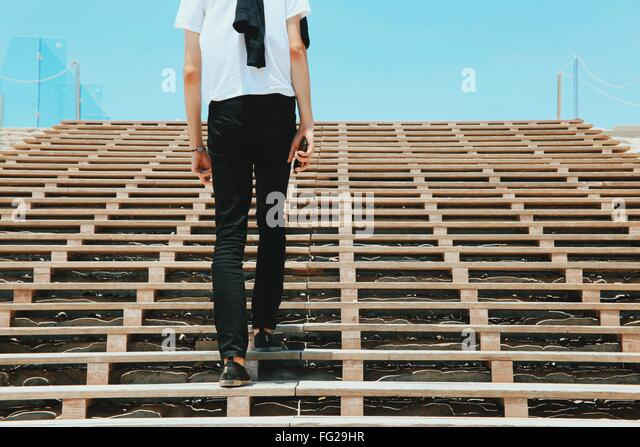 Low Angle View Of Man Walking On Steps - Stock Image