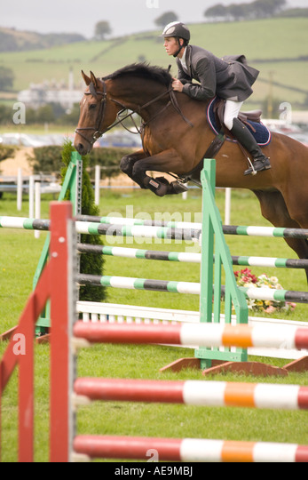 Equestrian sport horse riders show jumping competition horse jumping over jumps at Dumfries Agricultural Show Scotland - Stock Image